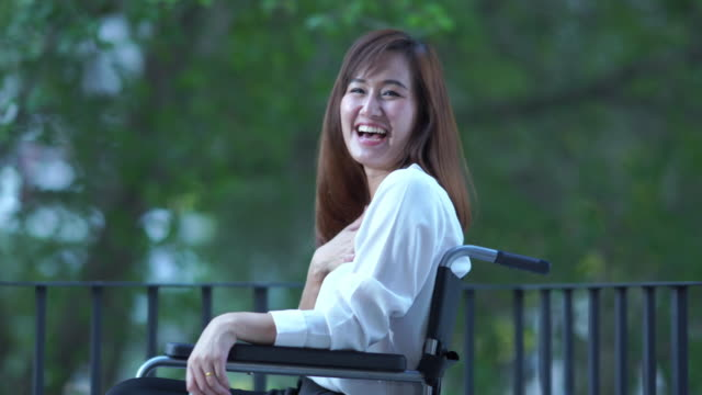 business patient woman  stting on wheelchair , feeling happiness at nursing home