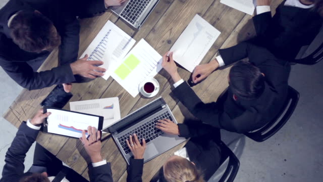 business people analyzing documents - corporate culture stock videos & royalty-free footage