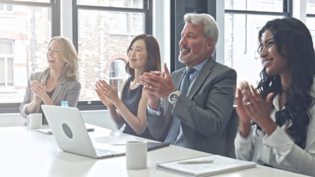 Business people applauding after a speech in an board room video