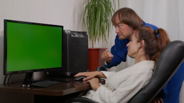 Business people at home with green screen chroma key TV or computer on the table. Diverse group of businessman and businesswoman in meeting on video conference call.