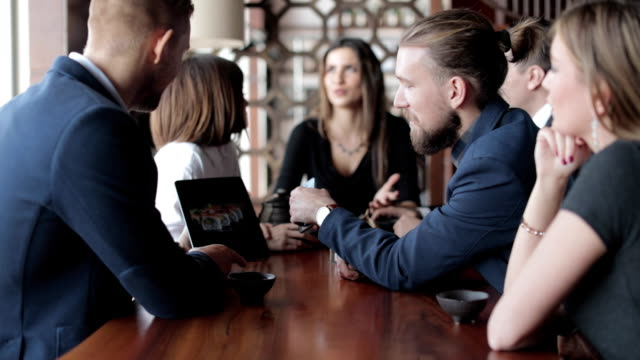 Business people at restaurant video