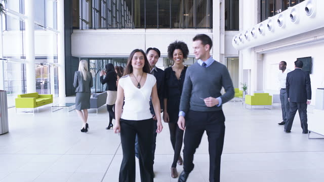 Business people bring jigsaw together video