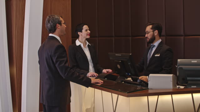 Business People Checking In the Hotel video