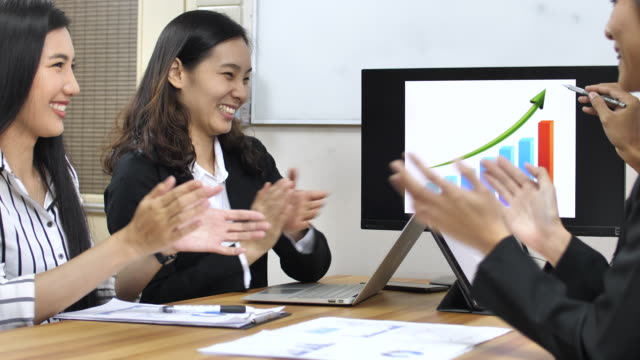Business people clapping for businessman in conference room Business people clapping for businessman in conference room east asian culture stock videos & royalty-free footage