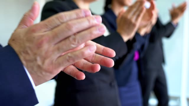 Business people clapping hands after the finished meeting.Cheer up concept. Business people clapping hands after the finished meeting. Professional education, work meeting, presentation or coaching concept. applauding stock videos & royalty-free footage