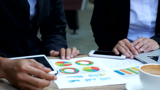 Business people developing a business project and analyzing market data information video