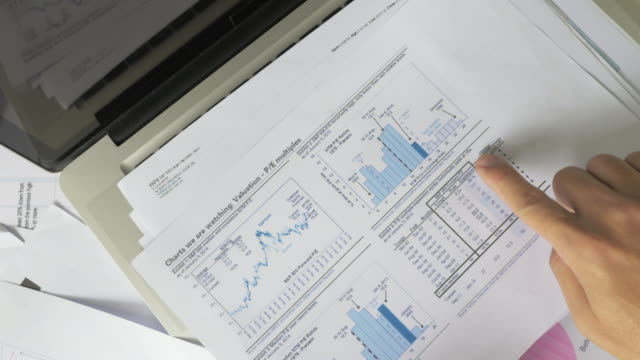 Business people developing a business project and analyzing market data. video