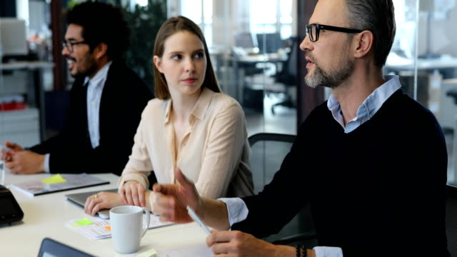 Business people discussing in meeting at office