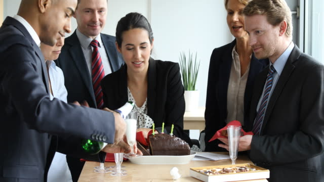 business people enjoying birthday party in office - office party stock videos and b-roll footage