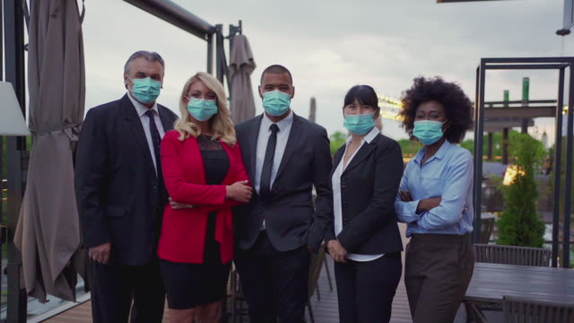 Business people following the recommended protection measures during a pandemic