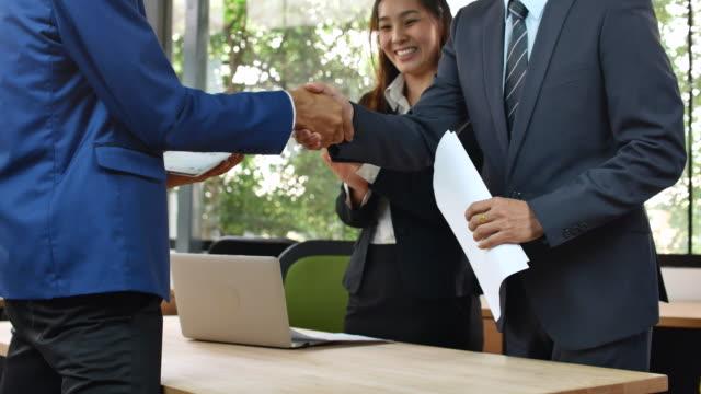 business people greeting - business handshake stock videos & royalty-free footage