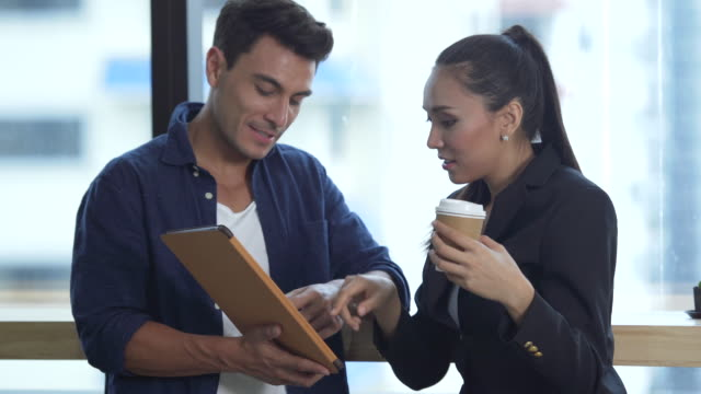 business people having a discussing with digital tablet - pausa caffè video stock e b–roll