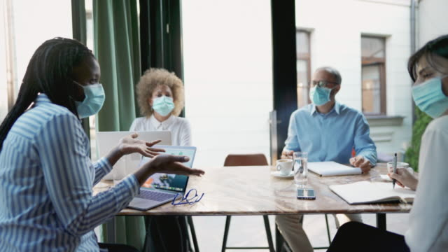 Business people having a meeting during the coronavirus pandemic