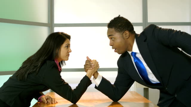 business people having an arm wrestle video