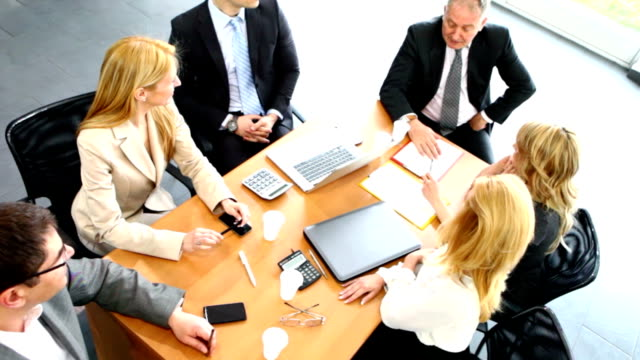 Business people having casual conversation during meeting. video