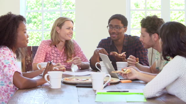 Business People Having Meeting And Eating Pizza video