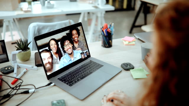 Business people having video call with colleagues working in office abroad Business people having video call with colleagues working in office abroad employee engagement stock videos & royalty-free footage