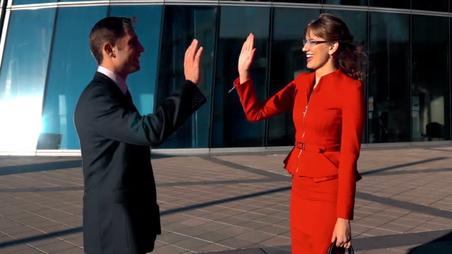 Business people high five outdoor video