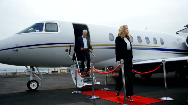 Business people leaving private jet 4k Business people leaving private jet at terminal 4k military private stock videos & royalty-free footage