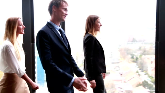 Business people meet up with other colleagues and shake hands video