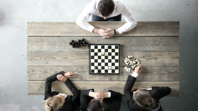 Business people playing chess video