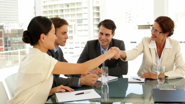 Business people shaking hands at interview video