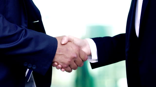 Business people shaking hands video