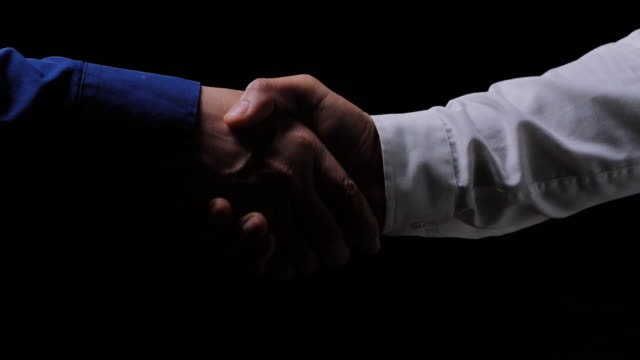 Business people shaking hands,finishing up a meeting on black background.Celebration,Success,Teamwork,Collaboration,Support,Togetherness,Business etiquette,Congratulation,Merger,Acquisition concepts.Handshakes: Non-Caucasian Handshakes: Non-Caucasian :Business people shaking hands,finishing up a meeting.Partner Businesst teamwork partnership on black background.Business trust teamwork, Vision, Celebration, Success, Teamwork, Collaboration, Support, Togetherness, Business etiquette, congratulation, Merger and acquisition concepts chance stock videos & royalty-free footage