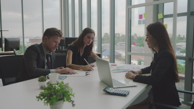 business people signing contract in an office. - firma video stock e b–roll