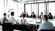 istock Business people sitting at table while female colleague giving presentation 510652002