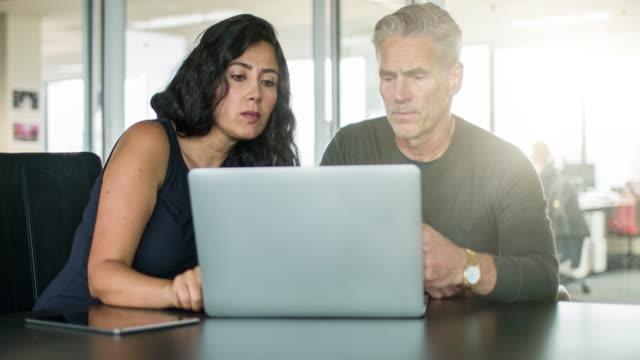 Business people talking in meeting video