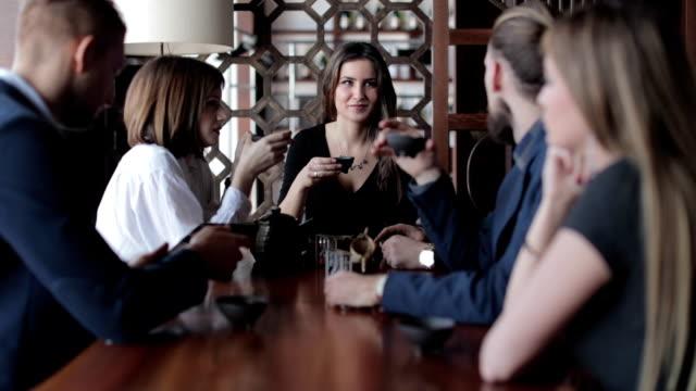Business people talking in restaurant video