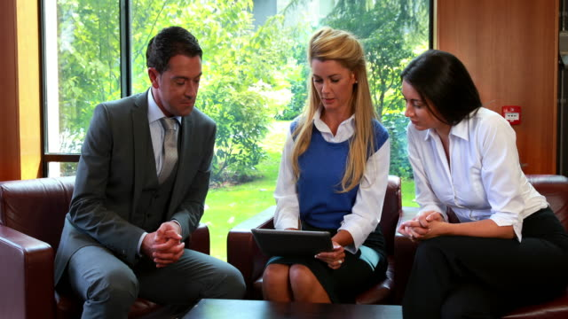 Business people using digital tablet in meeting video