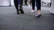 istock Business people walking in office corridor 1176752508