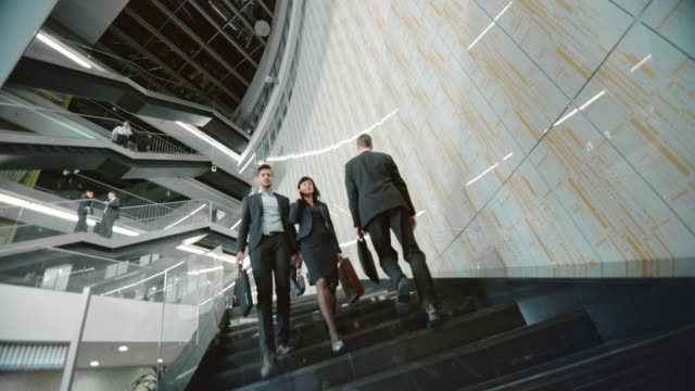 DS Business people walking up and down staircase video