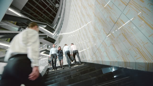 DS Business people walking up and down the stairs video