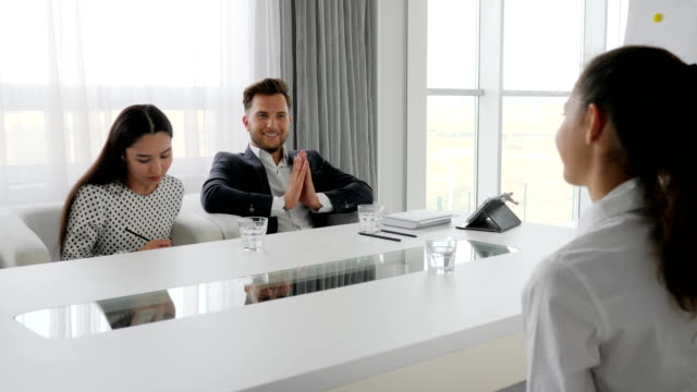 business people with glass water on table in conference room, creative team video
