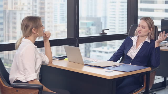 Business people with in office meeting Business people working and meeting in the office russian ethnicity stock videos & royalty-free footage