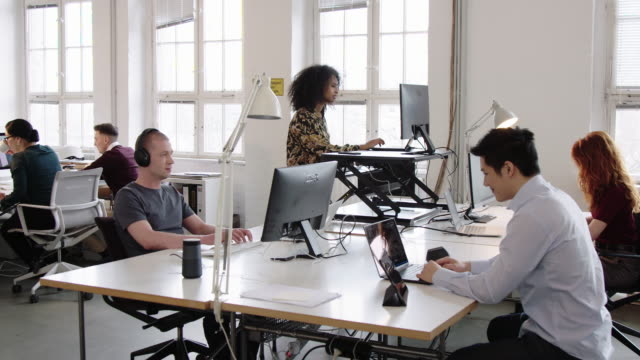 Business people working at a busy open plan office