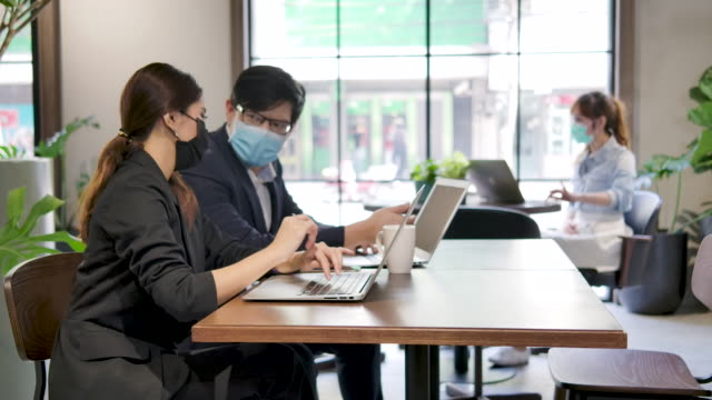business people working at desk in office. - businessman covid mask video stock e b–roll