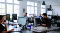 istock Business people working in a busy open plan office 1201224615
