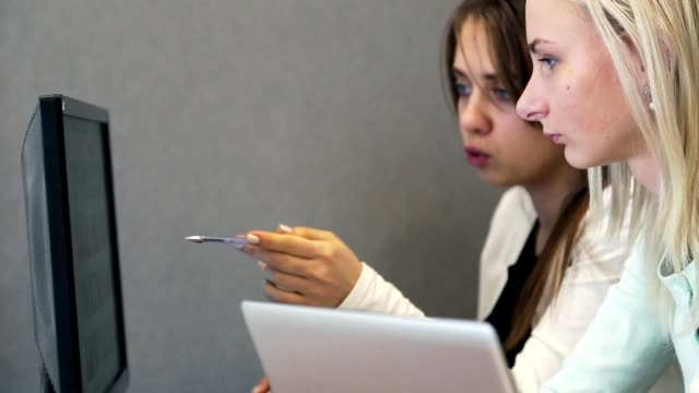 business people working with tablet and laptop in the office - coinvolgimento dei dipendenti video stock e b–roll