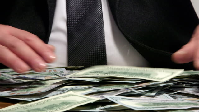 Business person grabbing US 100 dollars bank notes video