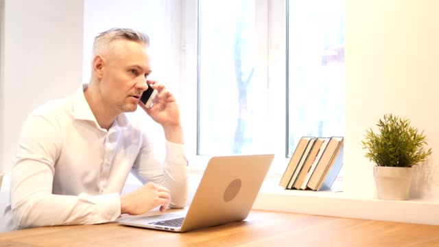 Business Phone Talk  at Work by Middle Age Man video