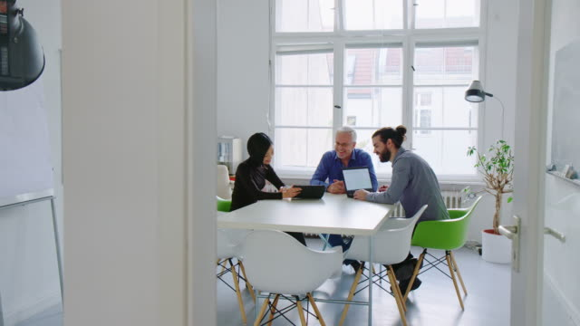 Business professionals working together in office conference room