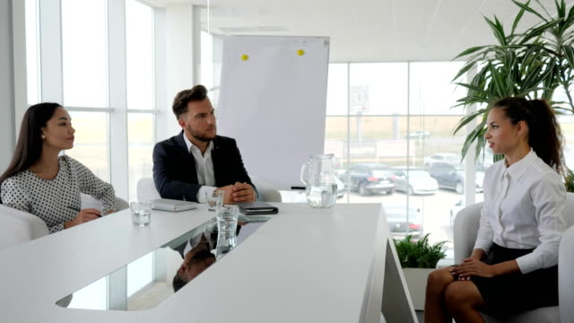 business team at table in white and spacious office, meeting with secretary and boss in boardroom, girl at modern office on job video