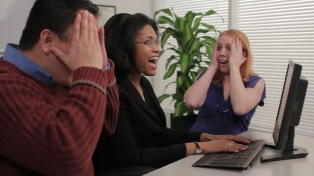 Business team celebrating good news video
