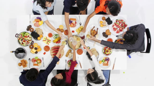 business team celebration party success concept.group of friends are eating food and socialising in a restaurant. - pranzo di natale video stock e b–roll