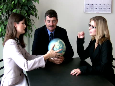 Business Team Discusses Global Prospects video