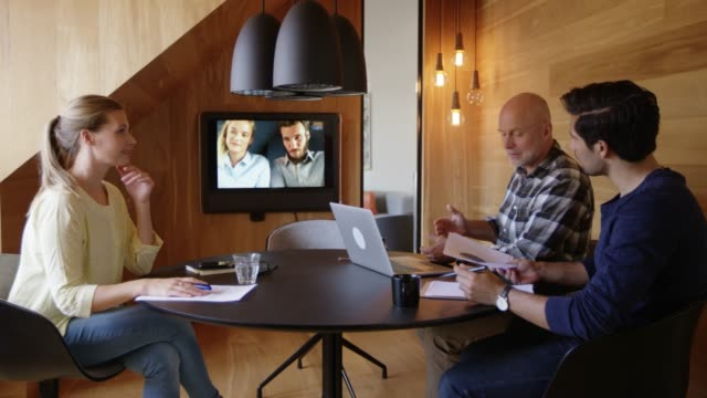 business team discussing during video conference - conference call stock videos & royalty-free footage